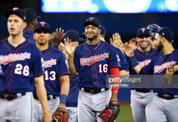 Jonathan Schoop of the Minnesota Twins celebrates with teammates after beating the Toronto Blue Jays in a MLB game at Rogers Centre on May 8 2019 in...