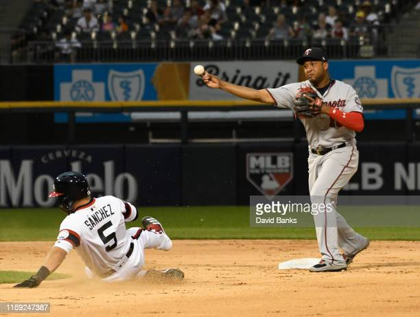 Jonathan Schoop of the Minnesota Twins forces out Yolmer Sanchez of the Chicago White Sox at second base then throws to first base to complete a...