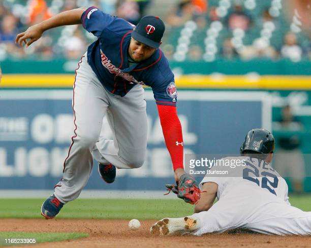 Jonathan Schoop of the Minnesota Twins loses the ball as Victor Reyes of the Detroit Tigers slides into second base with a steal during the first...