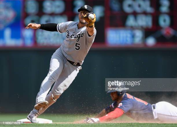 Jonathan Schoop of the Minnesota Twins slides safely into second base with a double as Yolmer Sanchez of the Chicago White Sox is unable to field the...