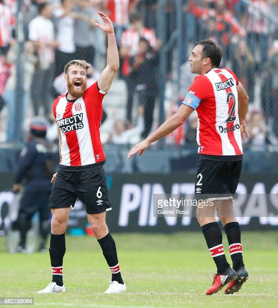 Jonathan Schunke and Leandro Desabato of Estudiantes celebrate after wining the match between Estudiantes and Gimnasia y Esgrima La Plata as part of...