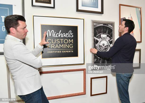 Jonathan Scott and Drew Scott celebrate the launch of their first custom framing program Scott Living available exclusively at Michaels on March 8...
