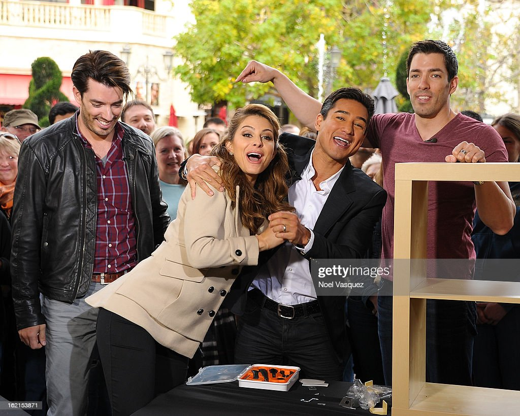 Jonathan Scott, Maria Menounos, Mario Lopez and Drew Scott visit Extra at The Grove on February 19, 2013 in Los Angeles, California.