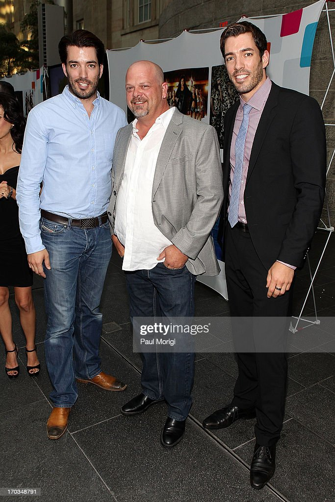Jonathan Scott (L), Rick Harrison (C) and Drew Scott pose for a photo at the A+E hosted NCTA Chairman's Reception at Smithsonian American Art Museum & National Portrait Gallery on June 11, 2013 in Washington, DC.