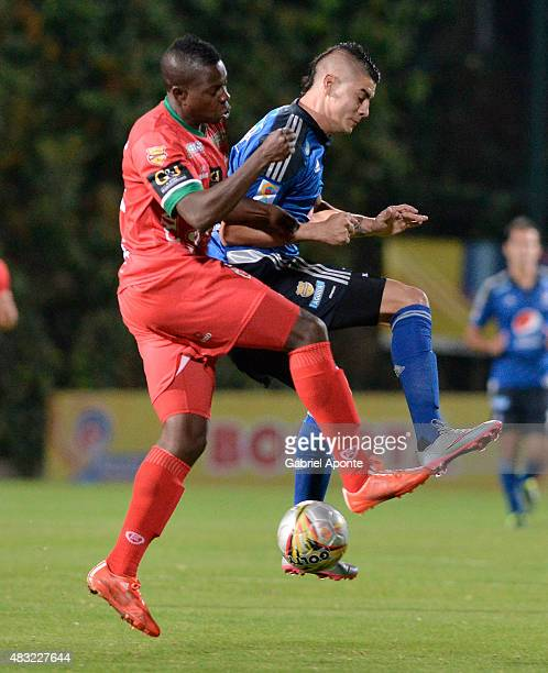 Jonathan Segura of Patriotas FC struggles for the ball with Michael Rangel of Millonarios during a match between Patriotas FC and Millonarios as part...