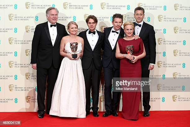 Jonathan Sehring Cathleen Sutherland Ellar Coltrane Ethan Hawke Patricia Arquette and John Sloss celebrate Best Film 'Boyhood' in the winners room at...