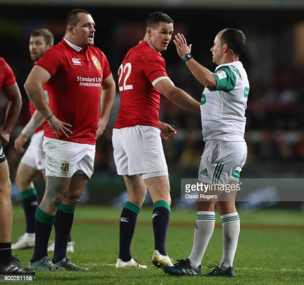 Jonathan Sexton and Ken Owens talk to referee Jaco Peyer during the Test match between the New Zealand All Blacks and the British Irish Lions at Eden...