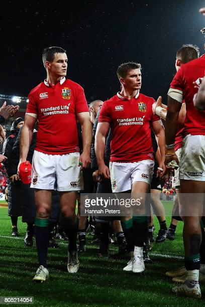 Jonathan Sexton and Owen Farrell of the Lions argue with members of the All Blacks as they walk off after winning the International Test match...
