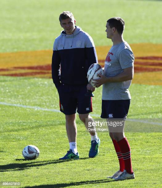 Jonathan Sexton is watched by team mate Owen Farrell during the British Irish Lions captain's run at Rotorua International Stadium on June 16 2017 in...