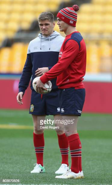 Jonathan Sexton looks on with Owen Farrell during the British Irish Lions kicking session at Westpac Stadium on June 30 2017 in Wellington New Zealand