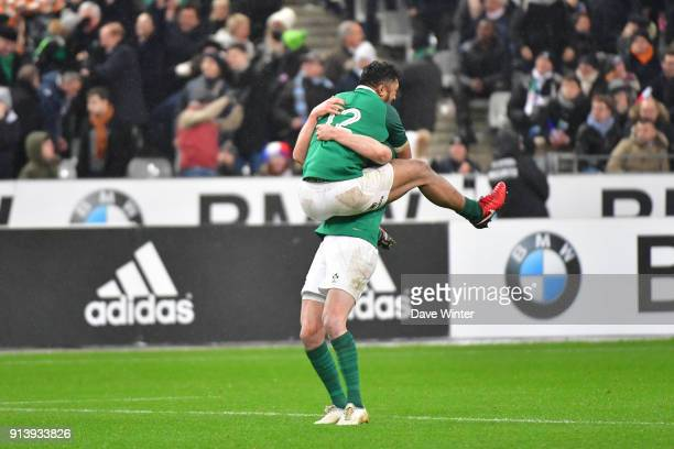 Jonathan Sexton of Ireland celebrates with Bundee Aki of Ireland after his injury time drop goal wins the RBS Six Nations match between France and...