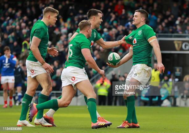 Jonathan Sexton of Ireland celebrates with team mates after scoring a try during the Guinness Six Nations match between Ireland and France at the...