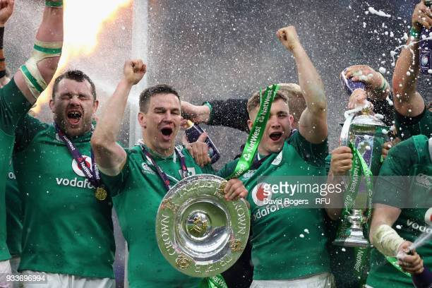 Jonathan Sexton of Ireland celebrates with team mates after their Grand Slam victory during the NatWest Six Nations match between England and Ireland...