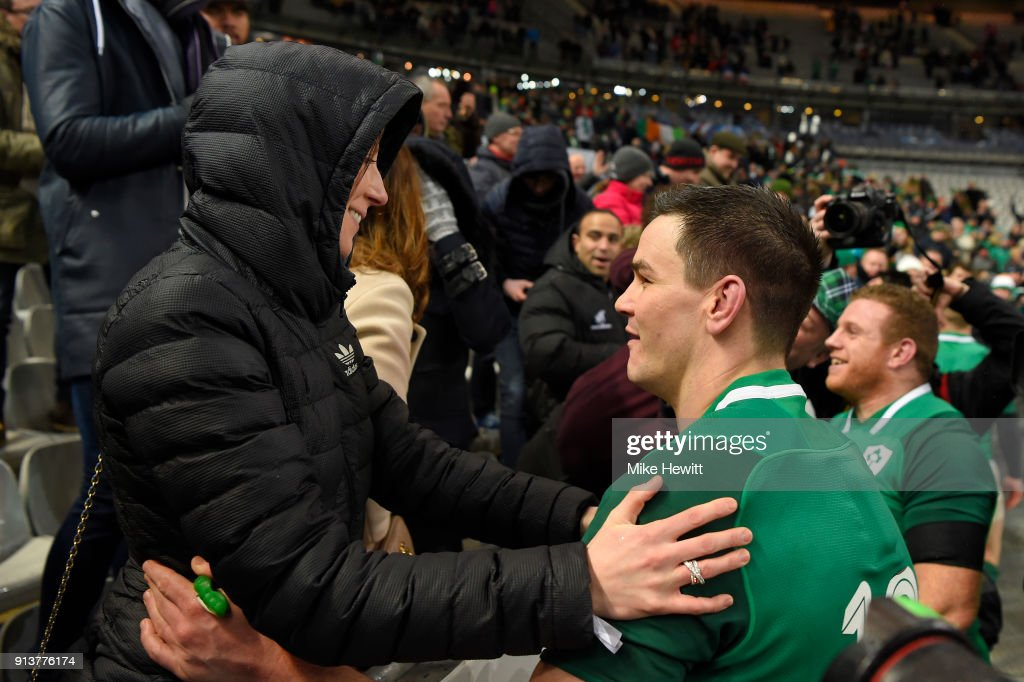 Jonathan Sexton of Ireland embraces his wife Laura after dropping a long range goal to win the match for Ireland in the NatWest Six Nations match between France and Ireland at Stade de France on February 3, 2018 in Paris, France.