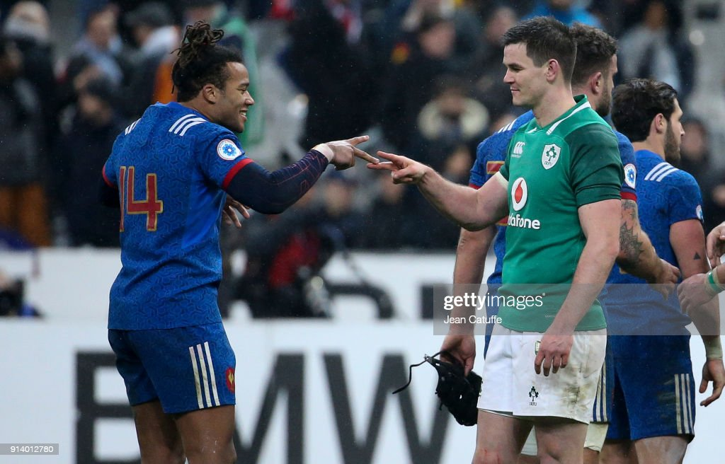 Jonathan Sexton of Ireland greets former teammate Teddy Thomas of France (left) following the NatWest 6 Nations (Tournoi des 6 Nations) match between France and Ireland at Stade de France on February 3, 2018 in Saint-Denis near Paris, France.