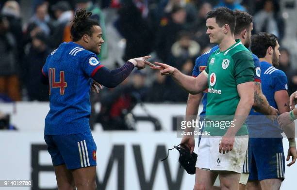 Jonathan Sexton of Ireland greets former teammate Teddy Thomas of France following the NatWest 6 Nations match between France and Ireland at Stade de...