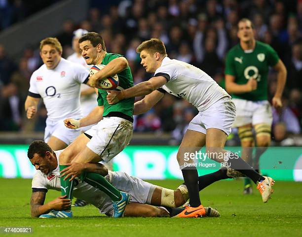 Jonathan Sexton of Ireland is tackled by Courtney Lawes and Owen Farrell of England during the RBS Six Nations match between England and Ireland at...