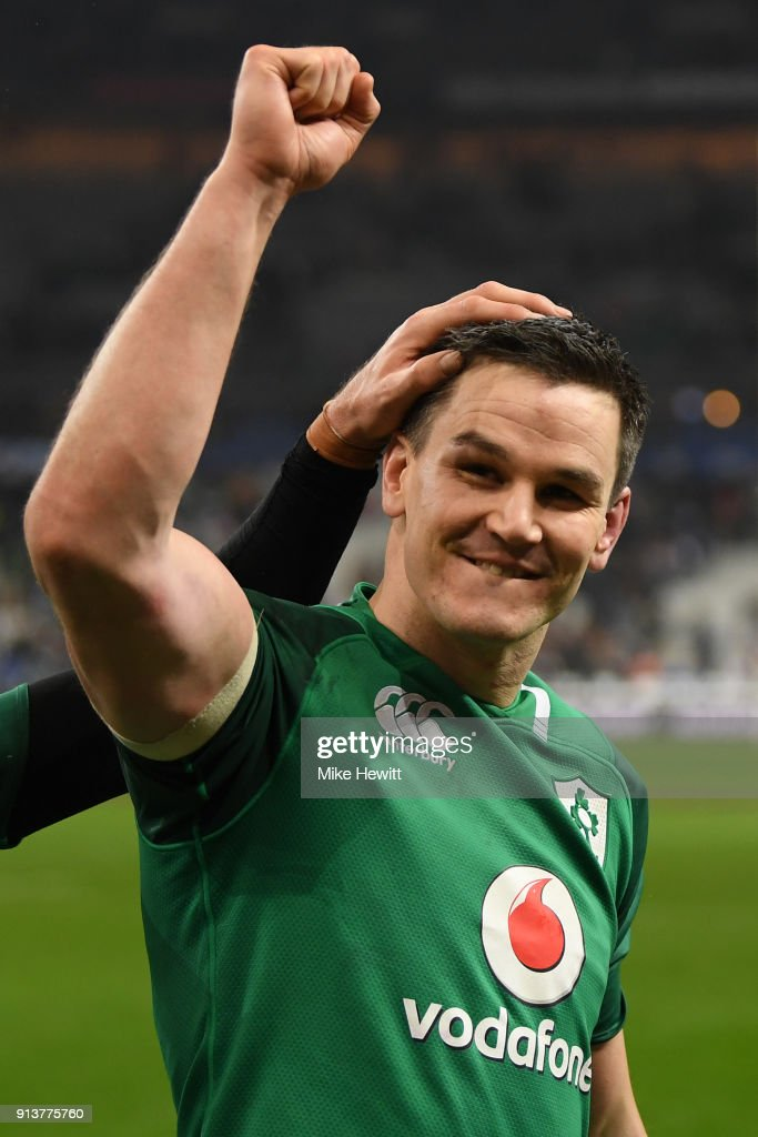 Jonathan Sexton of Ireland salutes the Irish fans after dropping a long range goal to win the match for Ireland in the NatWest Six Nations match between France and Ireland at Stade de France on February 3, 2018 in Paris, France.