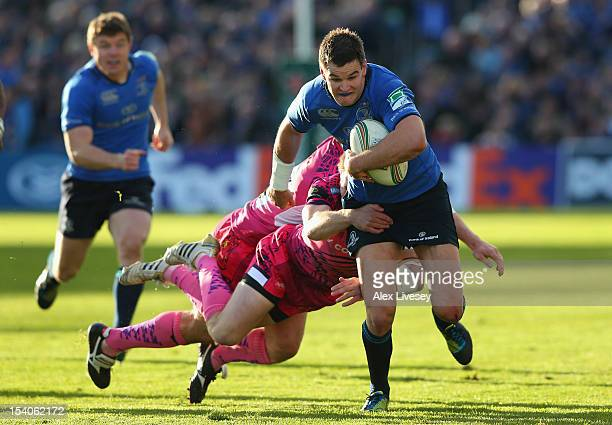 Jonathan Sexton of Leinster is tackled by Will Chudley and Ian Whitten of Exeter Chiefs during the Heineken Cup Pool 5 match between Leinster and...