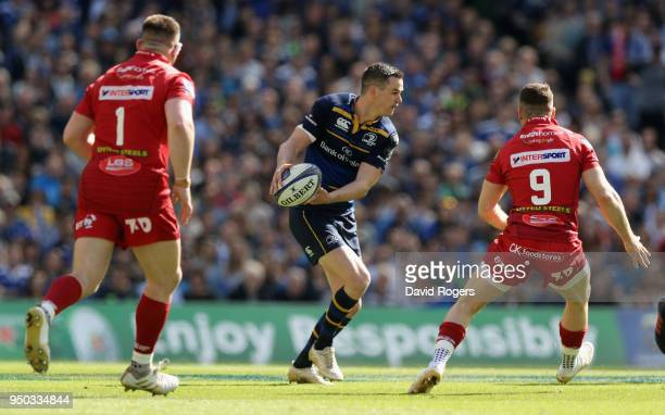 Jonathan Sexton of Leinster looks to off load the ball during the European Rugby Champions Cup SemiFinal match between Leinster Rugby and Scarlets at...
