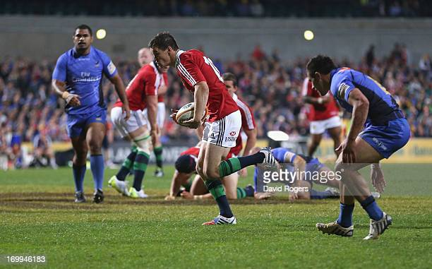 Jonathan Sexton of the Lions breaks clear to score the first try during the tour match between the Western Force and the British Irish Lions at...