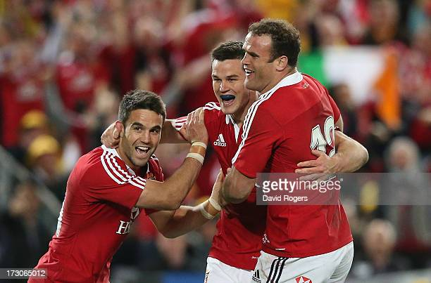 Jonathan Sexton of the Lions celebrates with team mates Conor Murray and Jamie Roberts after to scoring their second try during the International...