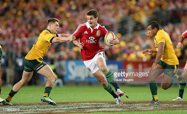 Jonathan Sexton of the Lions is tackled by James O'Connor during the International Test match between the Australian Wallabies and British Irish...
