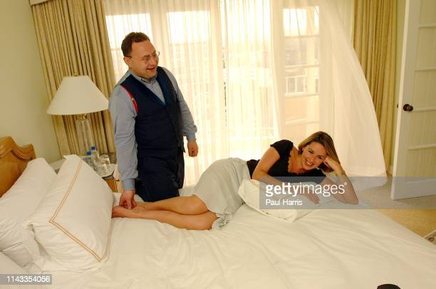 Jonathan Shalit tickles the foot of his latest client television presenter actress and now pop star Claire Sweeney lies on the bed of her suite at...