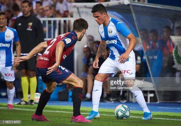 Jonathan Silva midfielder of CD Leganes competes for the ball with Nacho Vidal defender of CA Osasuna during the La Liga match between CD Leganes and...