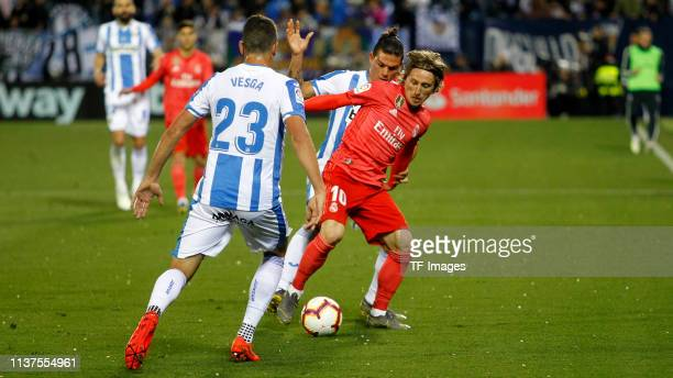 Jonathan Silva of CD Leganes and Luka Modric of Real Madrid CF battle for the ball during the La Liga match between CD Leganes and Real Madrid CF at...