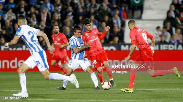 Jonathan Silva of CD Leganes and Marco Asensio of Real Madrid CF battle for the ball during the La Liga match between CD Leganes and Real Madrid CF...