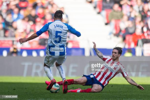 Jonathan Silva of CD Leganes and Sime Vrsaljko of Atletico de Madrid battle for the ball during the La Liga Santander match between Club Atletico de...