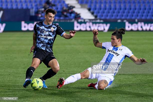 Jonathan Silva of CD Leganes battle for the ball with Aitor Bunuel of UD Almeria during the La Liga Smartbank match between CD Leganes and UD Almeria...
