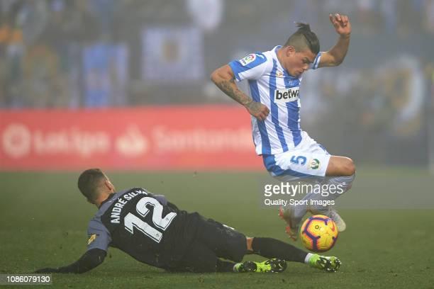 Jonathan Silva of CD Leganes competes for the ball with Andre Silva of Sevilla FC during the La Liga match between CD Leganes and Sevilla FC at...
