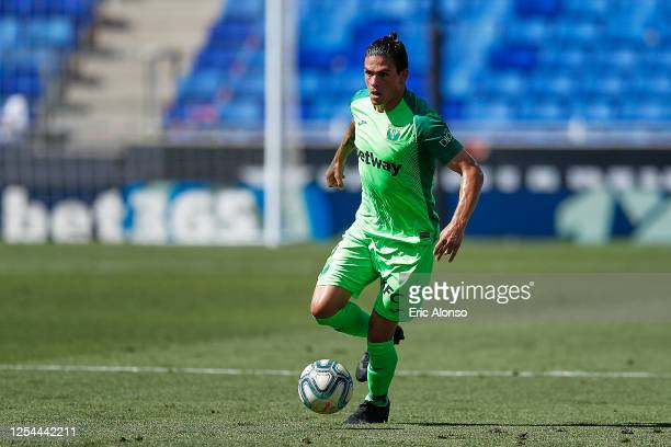 Jonathan Silva of CD Leganes controls the ball during the Liga match between RCD Espanyol and CD Leganes at RCDE Stadium on July 05, 2020 in...
