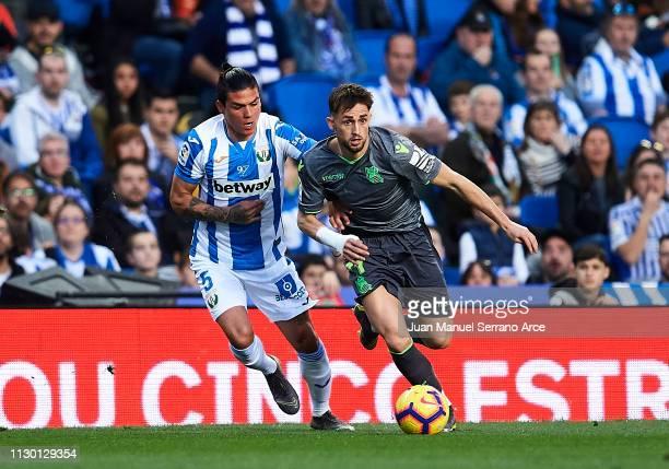 Jonathan Silva of CD Leganes duels for the ball with Adnan Januzaj of Real Sociedad during the La Liga match between Real Sociedad and CD Leganes at...