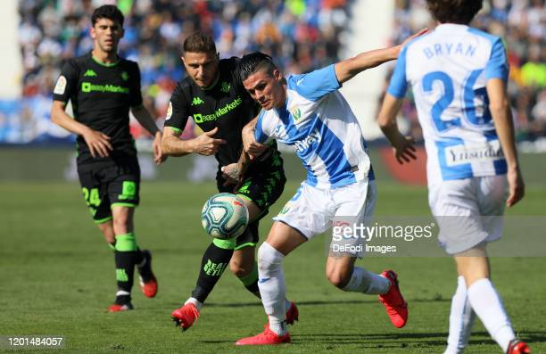 Jonathan Silva of CD Leganes, Joaquin Sanchez of Real Betis battle for the ball during the Liga match between CD Leganes and Real Betis Balompie at...