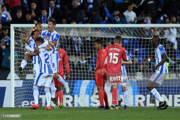 Jonathan Silva of Leganes celebrates with his team after scoring the opening goal during the La Liga match between CD Leganes and Real Madrid CF at...