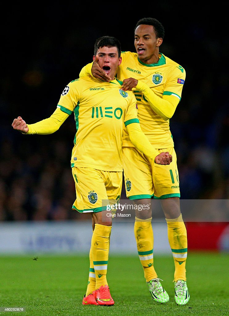 Jonathan Silva of Sporting Lisbon celebrates with teammate Andre Carrillo of Sporting Lisbon scoring his team's first goal during the UEFA Champions League group G match between Chelsea and Sporting Clube de Portugal at Stamford Bridge on December 10, 2014 in London, United Kingdom.