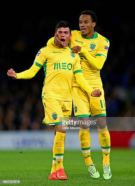 Jonathan Silva of Sporting Lisbon celebrates with teammate Andre Carrillo of Sporting Lisbon scoring his team's first goal during the UEFA Champions...
