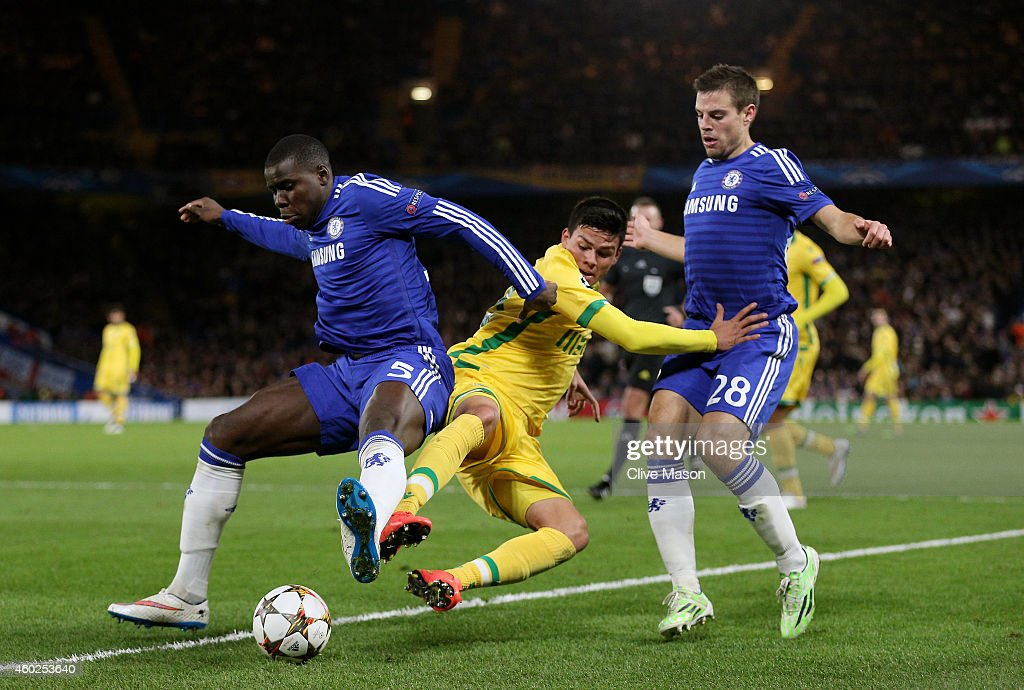 Jonathan Silva of Sporting Lisbon is closed down by Kurt Zouma (L) of Chelsea and Cesar Azpilicueta (R) of Chelsea during the UEFA Champions League group G match between Chelsea and Sporting Clube de Portugal at Stamford Bridge on December 10, 2014 in London, United Kingdom.