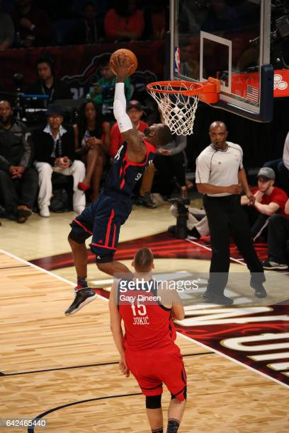 Jonathan Simmons of the US Team dunks against Nikola Jokic of the World Team during the BBVA Compass Rising Stars Challenge on February 17 2017 at...