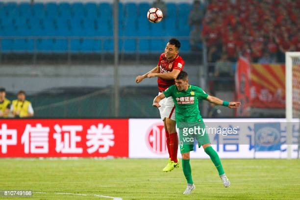 Jonathan Soriano of Beijing Guaoan and Feng Xiaoting of Guangzhou Evergrande head the ball during the 16th round match of 2017 Chinese Football...