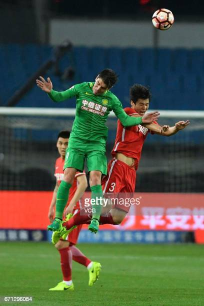 Jonathan Soriano of Beijing Guoan and Wang Jie of Tianjin Quanjian compete for the ball during the 6th round match of China Super League between...