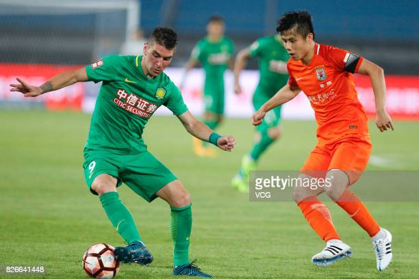 Jonathan Soriano of Beijing Guoan controls the ball during the 20th round match of 2017 Chinese Football Association Super League between Beijing...