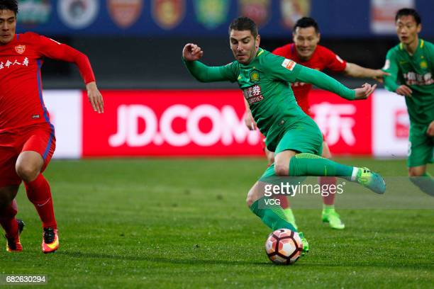 Jonathan Soriano of Beijing Guoan controls the ball during the 9th round match of 2017 Chinese Football Association Super League between Yanbian Fude...