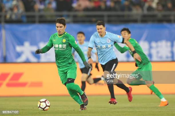 Jonathan Soriano of Beijing Guoan drives the ball during the 2018 Chinese Football Association Super League third round match between Dalian Yifang...