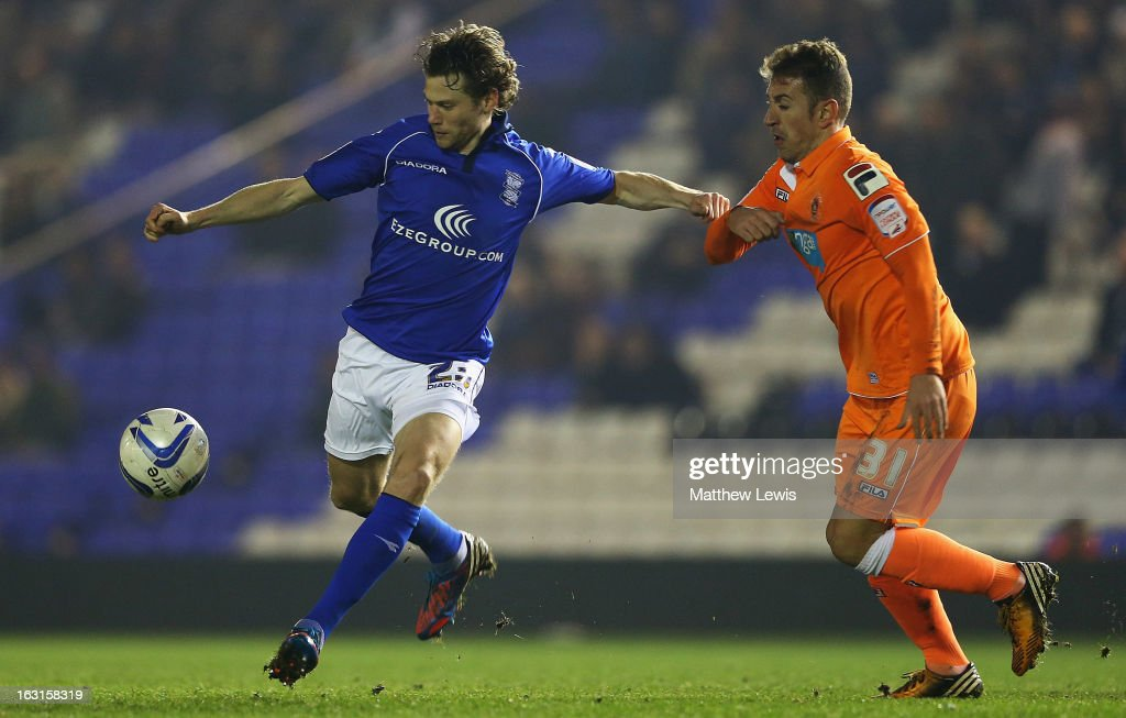 Jonathan Spector of Birmingham and Angel Martinez of Blackpool chalenge for the ball during the npower Championship match between Birmingham City and Blackpool at St Andrews on March 5, 2013 in Birmingham, England.