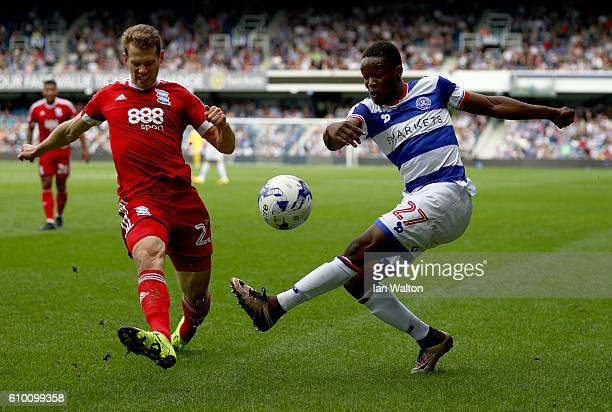 Jonathan Spector of Birmingham City tries Olamide Shodipo of QPR during the Sky Bet Championship match between Queens Park Rangers and Birmingham...