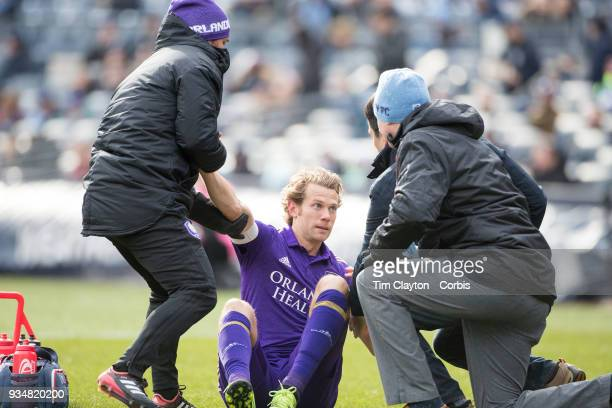 Jonathan Spector of Orlando City is treated by medical staff after a head clash during the New York City FC Vs Orlando City SC regular season MLS...